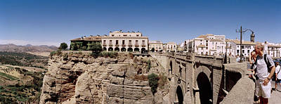 Ronda Photograph - Tourists Standing On A Bridge, Puente by Panoramic Images