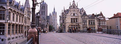 Belgium Photograph - Tourists Walking In Front Of A Church by Panoramic Images