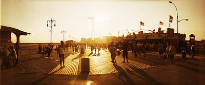 Coney Island Photograph - Tourists Walking On A Boardwalk, Coney by Panoramic Images