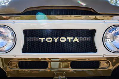 Antique Cars Photograph - Toyota Land Cruiser Grille Emblem  by Jill Reger