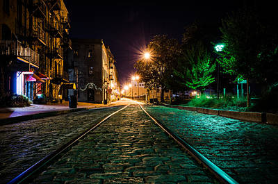 Photograph - Tracks On The Riverwalk At Night by Anthony Doudt