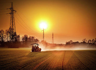 Tractor In A Field At Sunset Art Print by Rinocdz