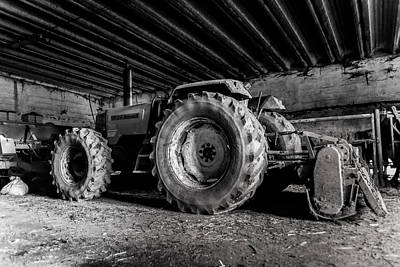 Photograph - Tractor In The Barn by Joseph Amaral