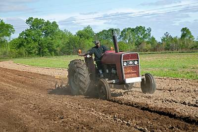 Hattiesburg Photograph - Tractor Ploughing A Field by Jim West
