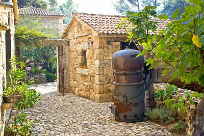 Photograph - Traditional Brandy Still In Stone Village by Brch Photography