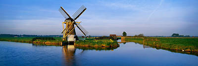 Landscape Netherlands Photograph - Traditional Windmill On The Waterfront by Panoramic Images