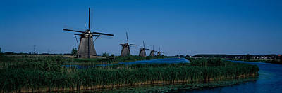 Rotterdam Photograph - Traditional Windmills At A Riverbank by Panoramic Images