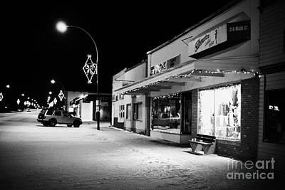 traditional window of fashion store at night in town of Biggar Saskatchewan Canada Art Print