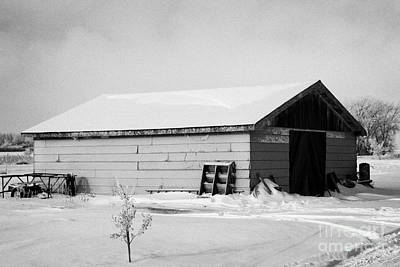 traditional wooden plank barn in rural village Forget Saskatchewan Canada Art Print by Joe Fox