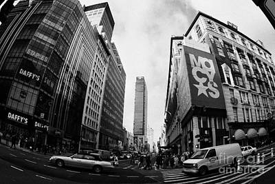 traffic crossing intersection outside Macys at Broadway and 34th Street Herald Square new york usa Art Print by Joe Fox