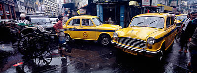 Monsoons Photograph - Traffic In A Street, Calcutta, West by Panoramic Images