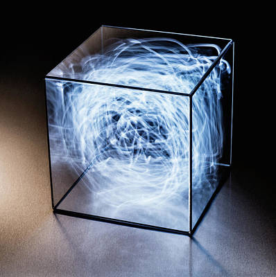 Trapped Photograph - Trails Of Blue Light In Clear Box by Pm Images