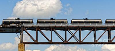 Blue Hues - Train cars on the bridge by Les Palenik