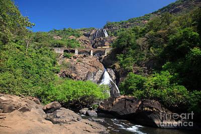 Natural Bridge Station Photograph - Train Crossing Dudhsagar Falls by Deborah Benbrook