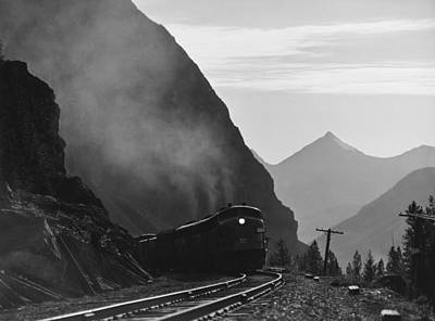 Canadian Rockies Photograph - Train In Canadian Rockies by Underwood Archives