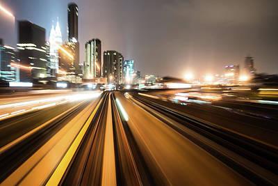 Photograph - Train Through Moden City by Loveguli
