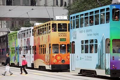 Trams On The Street In Hong Kong Art Print