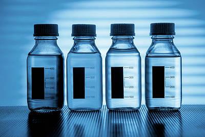 Transparent Liquids In Plastic Bottles Art Print by Wladimir Bulgar