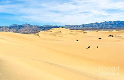 Travelers - Three People Walking Across The Sand Dunes In Death Valley National Park In California Art Print by Jamie Pham