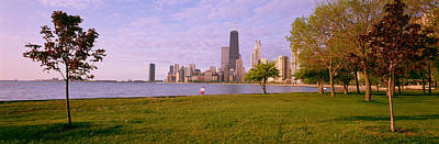 Trees In A Park With Lake And Buildings Art Print by Panoramic Images