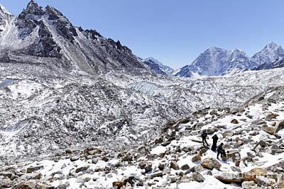 Trekkers En Route To Everest Base Camp In The Everest Region Of Nepal Art Print by Robert Preston