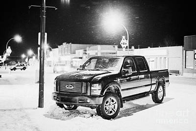 truck parked on the main street at night in snowstorm Biggar Saskatchewan Canada Art Print