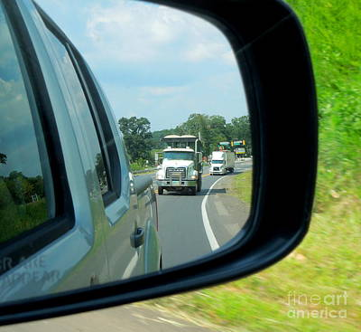 Photograph - Trucks In Rear View Mirror by Renee Trenholm
