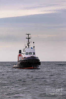From The Kitchen - Tugboat floating in wait on calm ocean at anchor by Stephan Pietzko