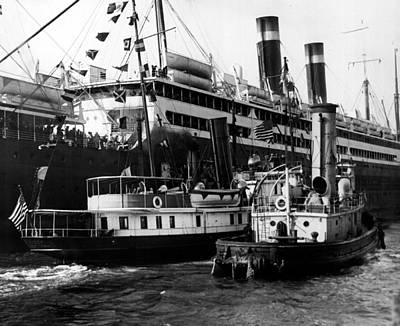 Tugboats Photograph - Tugboats Beside Bigger Ship by Retro Images Archive