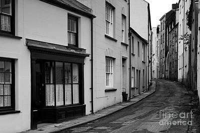 Buildings And Narrow Lanes Photograph - Turning Back by Doug Wilton