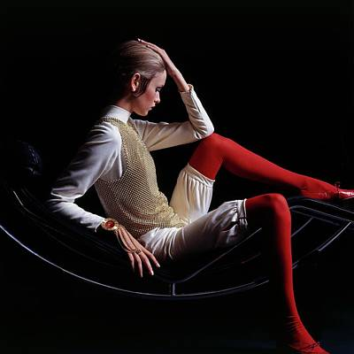 Black Background Photograph - Twiggy Sitting On A Modern Chair by Bert Stern