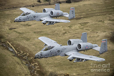 Two A-10 Thunderbolt IIs Conduct Art Print by Stocktrek Images