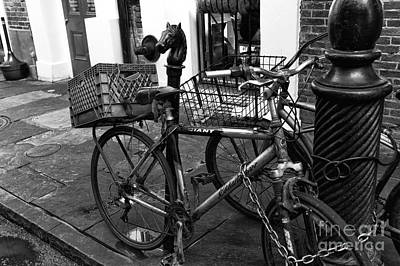Two Bicycles In New Orleans Mono Art Print by John Rizzuto
