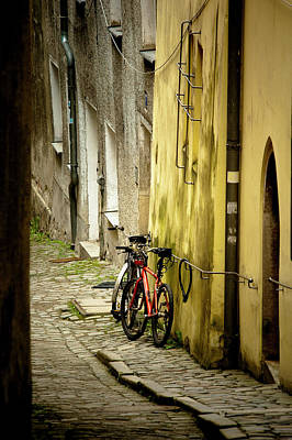 Two Bicycles On Cobblestone Street Art Print by Sheila Haddad