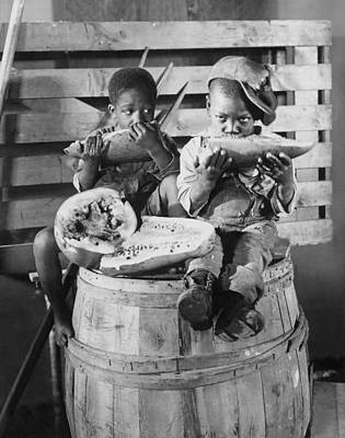 Two Boys Eating Watermelon Art Print by Underwood Archives