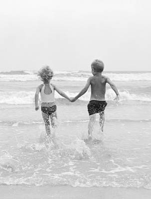 Photograph - Two Children Running Into The Ocean by H Armstrong Roberts and ClassicStock