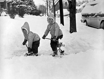 Two Children Shoveling Snow Art Print by Underwood Archives