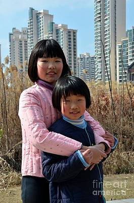 Two Chinese Teen Sisters Hug  And Embrace Shanghai China Art Print