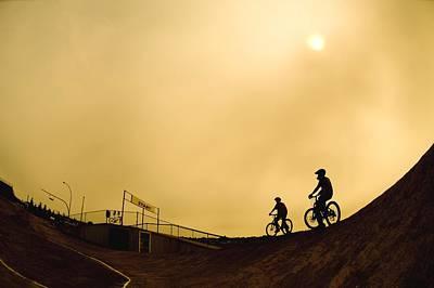 Two Cyclists Print by Corey Hochachka