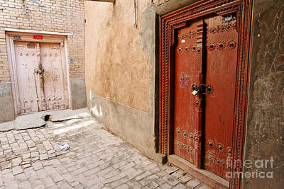 Two Doors In The Old Town Of Kashgar Art Print by Robert Preston