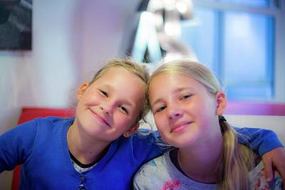 Candid Photograph - Two Girls Smiling Arms Around Each Other by Samuel Ashfield