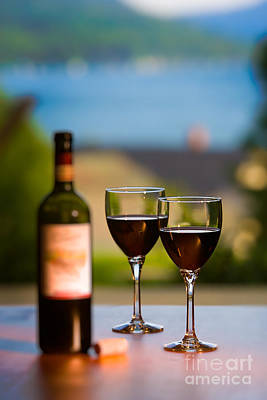 Photograph - Two Glasses And A Bottle Of Red Wine. by Don Landwehrle