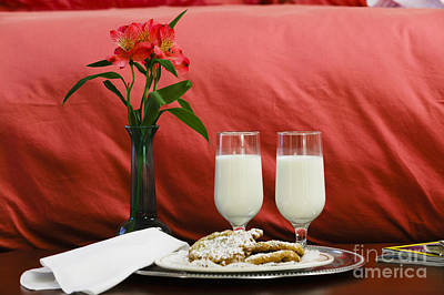 Photograph - Two Glasses Of Milk And Flowers At The Foot Of A Hotel Bed. by Don Landwehrle