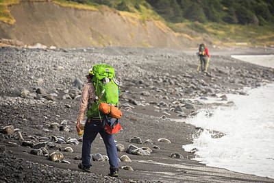 Two Hikers On A Rocky Beach Art Print