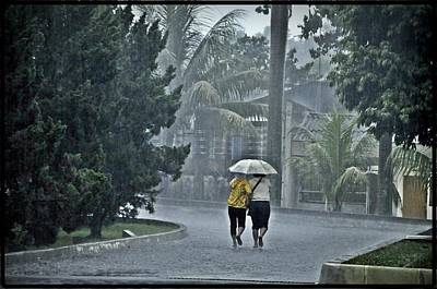 Photograph - Two Ladies With One Umbrella by Achmad Bachtiar