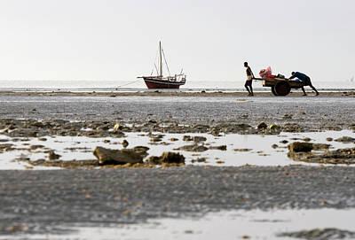 Dhow Photograph - Two Men Pushing A Cart, Peponi Beach by Kerstin Geier