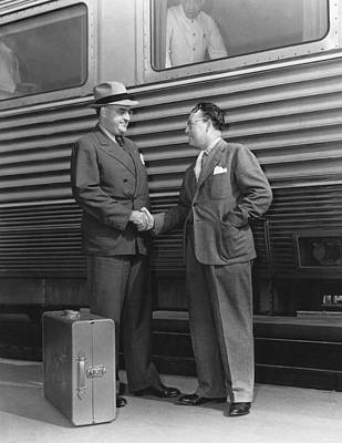 Two Men Shaking Hands At Train Art Print