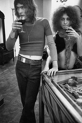Alcoholic Drink Photograph - Two Models Wearing 1970s Style Clothing by Rene De Bauge-Cahan