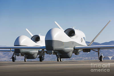 Uca Photograph - Two Mq-4c Triton Unmanned Aerial by Stocktrek Images