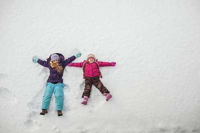Two Sisters Playing, Making Snow Angels Art Print by Hugh Whitaker